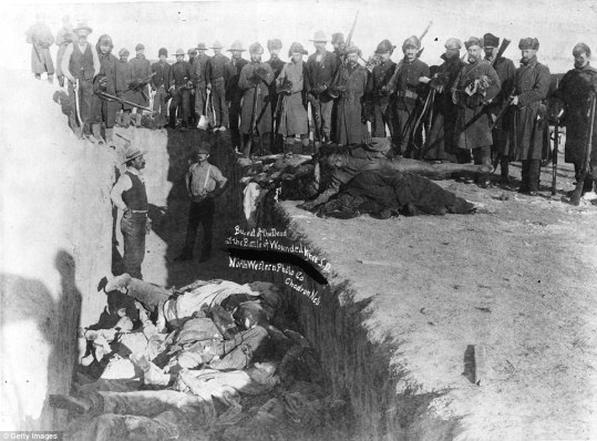 Mass burial of Native Americans at Wounded Knee, South Dakota:  http://en.wikipedia.org/wiki/Wounded_Knee_Massacre