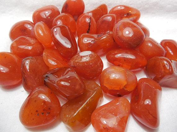 Some tumbled `aqeeq stones.